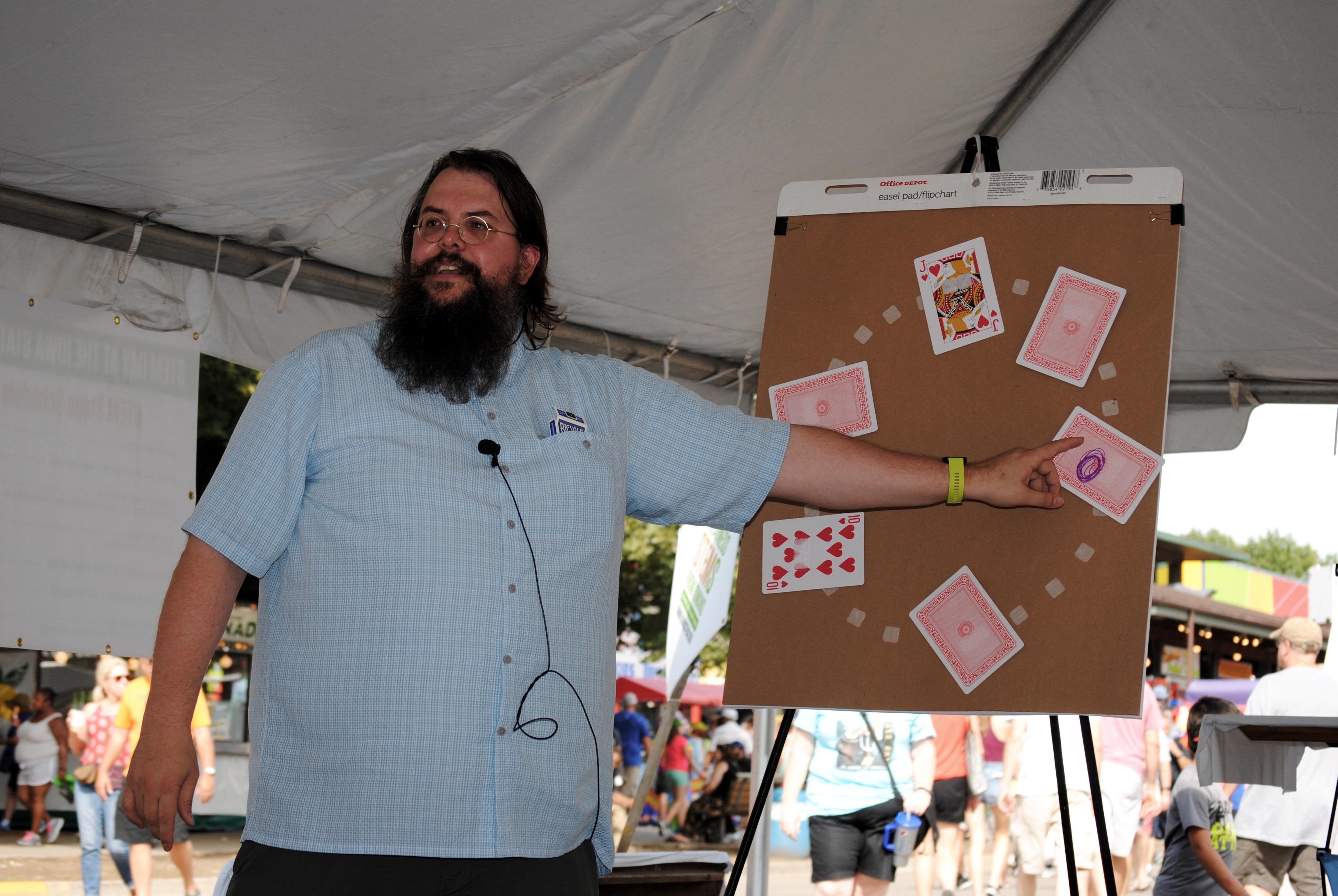 Steve Butler explains the math behind card tricks at the Iowa State Fair.