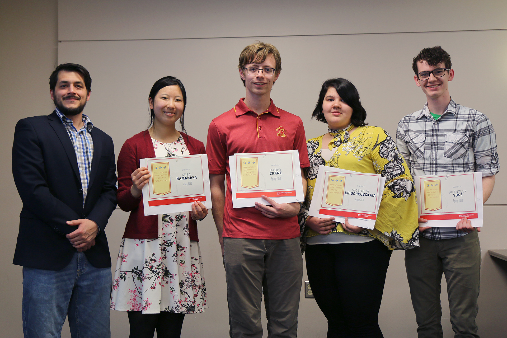 Kris Lee with the recipients of the Fred Wright Mathematics Endowed Scholarship (from left) Misa Hamanaka, Harry Crane, Victoriia Kriuchkovskaia, Brantley Vose. Not pictured: Samson Baker and Bailey Wilson.