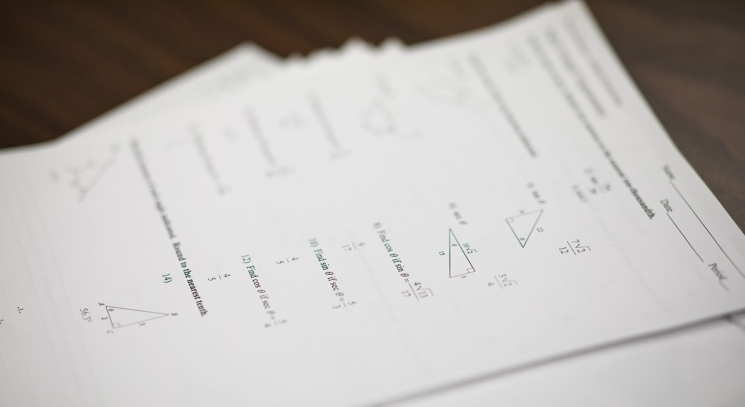 Math practice sheets on a table