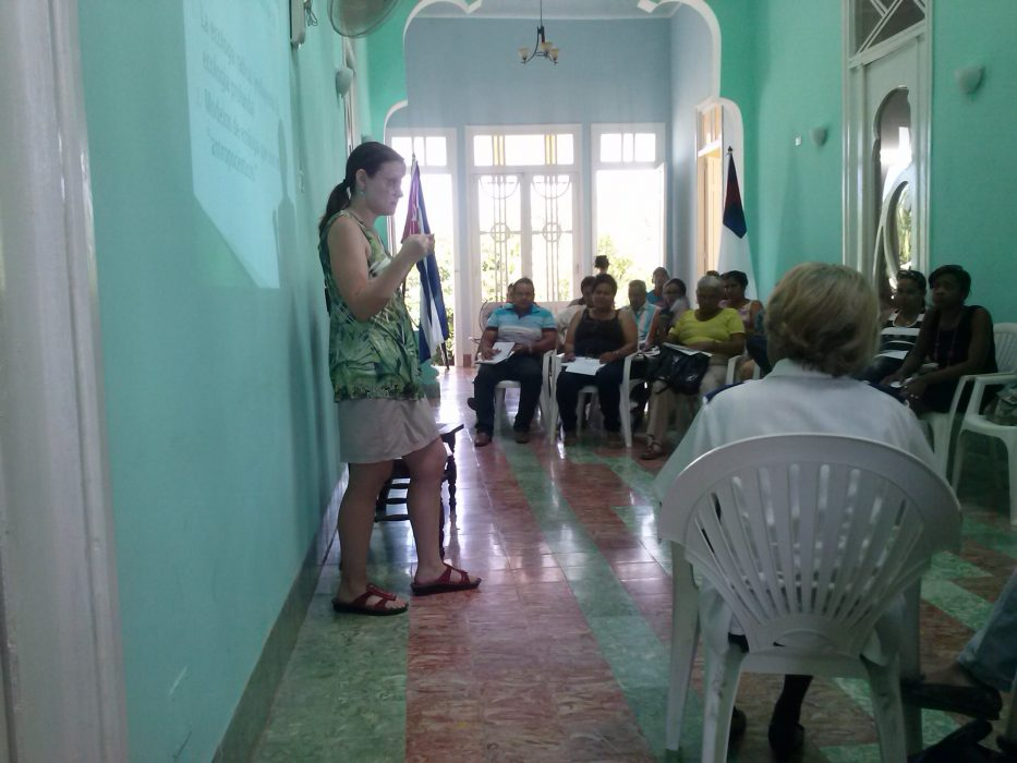Dr. Rose Caraway delivering a presentation on deep ecology (an ecological and environmental philosophy advocating the inherent worth of all living beings) at the Centro Cristiano Lavastida in Santiago de Cuba.