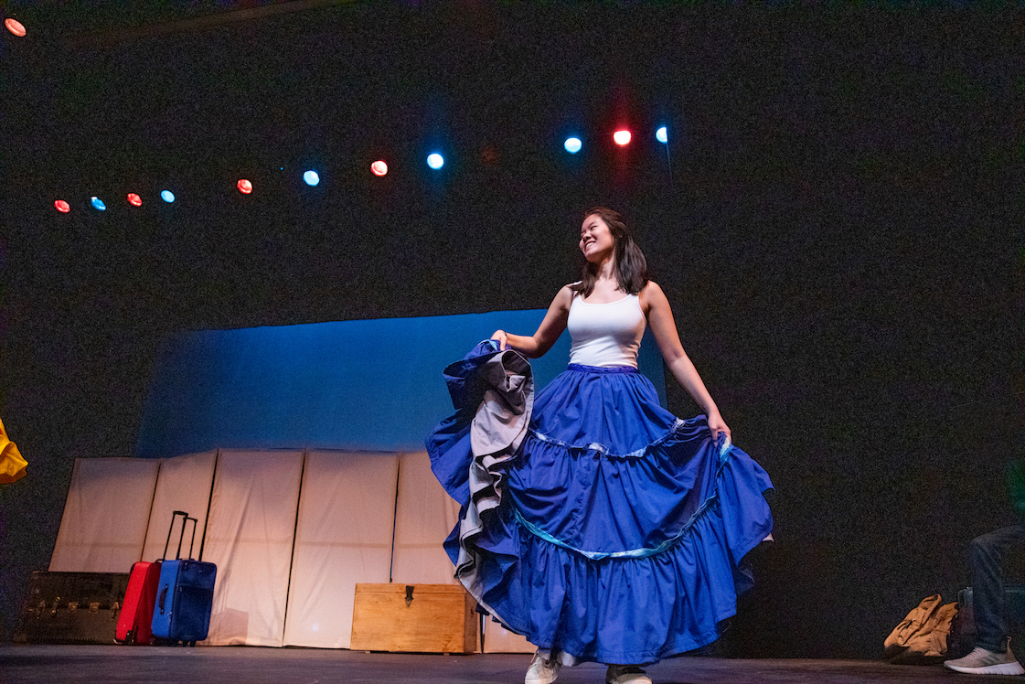 Woman on stage in blue skirt