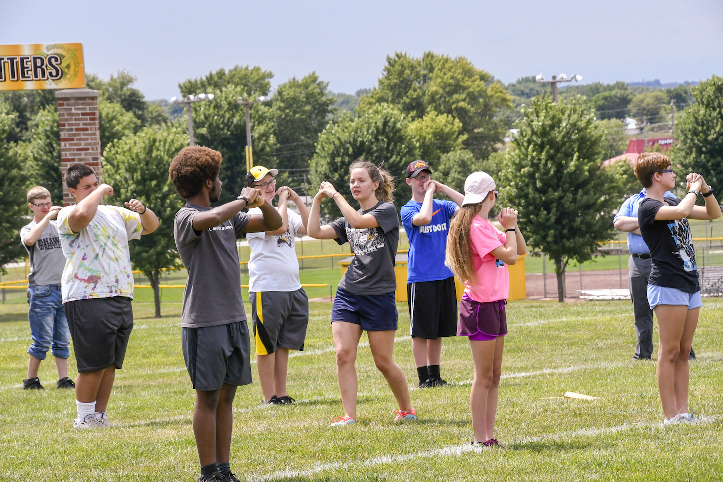 High school marching band practices on a field