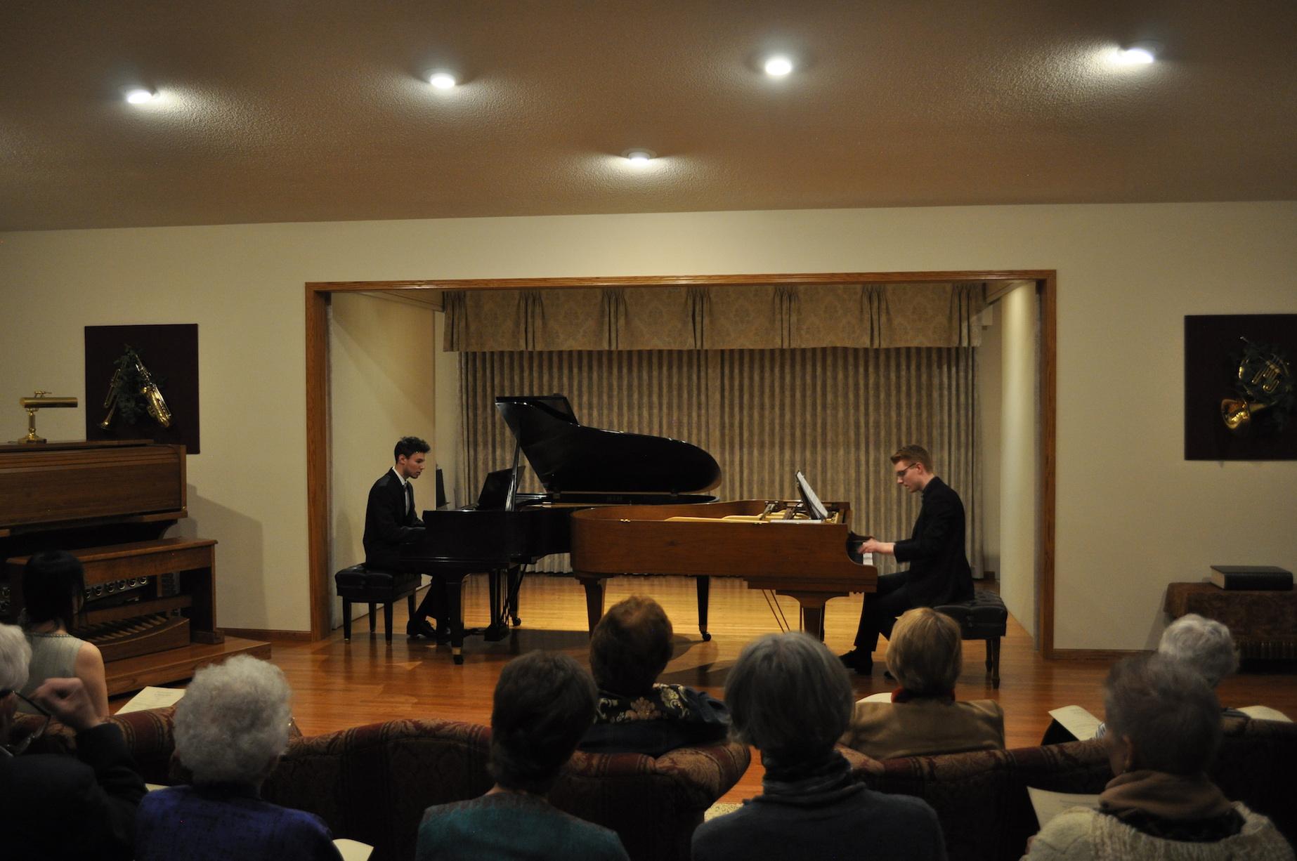 Two men playing piano