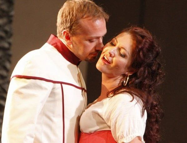 Opera singer Wayne Tigges performs on stage with a fellow actress and opera singer
