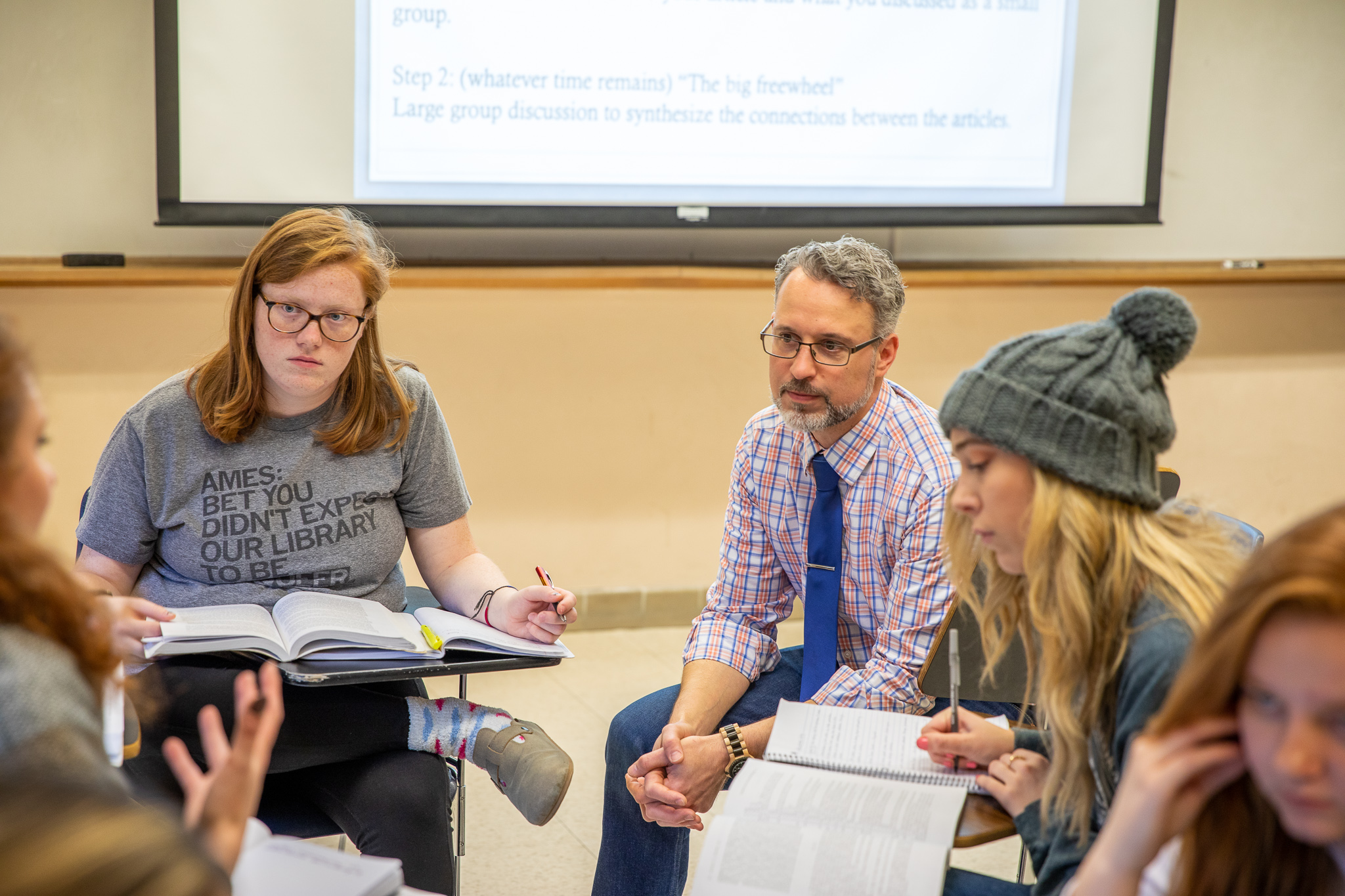Assistant teaching professor Michael Goebel and students in WGS 430